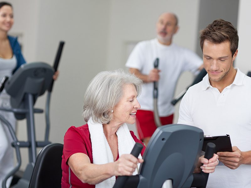 Senior woman with a personal fitness trainer